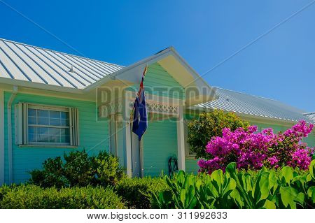 Little Cayman, Cayman Islands, Nov 2018, Green Caribbean-style House With Tin Roof By Guy Banks Road