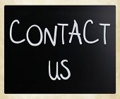 """Contact Us"" handwritten with white chalk on a blackboard poster"