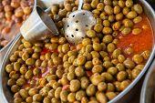 Selective large pickled olives in brine in outdoor market poster