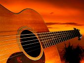 the bridge of an acoustic guitar points off into the sunset. poster