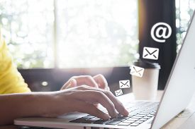 Hand Of Female Using Laptop Computer Sending E-mail Message With Email Address Symbol And Envelope I