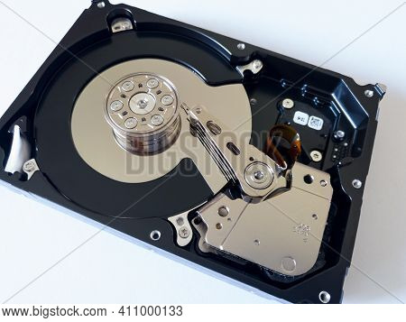 Repair Broken Computer Part, Close Up Of Open Hard Disc Drive (hdd) With Platters, Spindle, Actuator