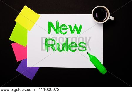 A Sheet Of Paper With The Words New Rules, A Cup Of Coffee, Bright Multi-colored Stickers For Notes