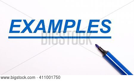 On A Light Background, An Open Blue Felt-tip Pen And The Text Examples