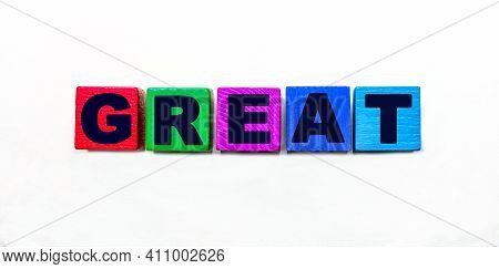 The Word Great Is Written On Colorful Cubes On A Light Background