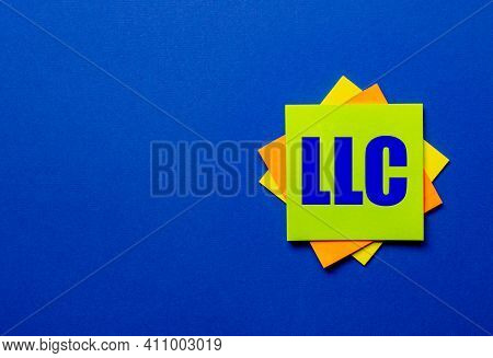 The Words Llc Limited Liability Company Is Written On Bright Stickers On A Blue Background