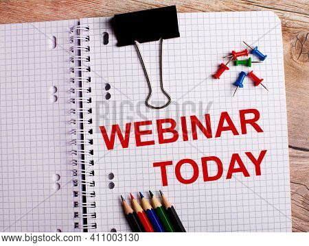 The Words Webinar Today Is Written In A Notebook Near Multi-colored Pencils And Buttons On A Wooden