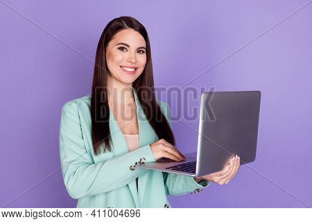 Photo Of Charming Young Businesswoman Hold Hands Computer Work Freelancer Isolated On Purple Color B