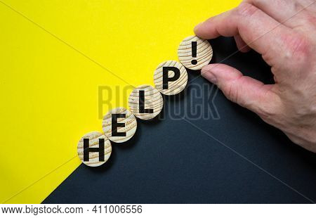 Support And Help Symbol. Wooden Circles With The Word 'help'. Businessman Hand. Business, Psychology