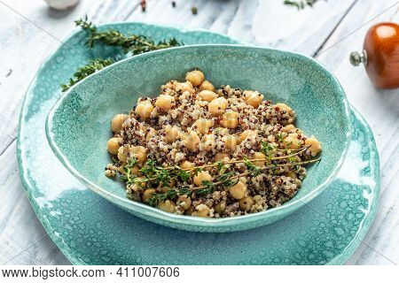 Bowl Of Quinoa Salad With Chickpeas And Thyme. Super Food, Food Recipe Background. Close Up,