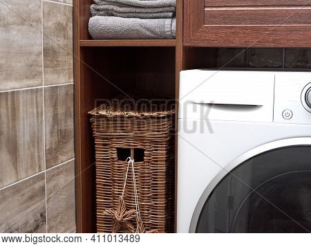 Scandinavian Interior Of Laundry Room. Close Up Of A Wicker Laundry Basket And Clean Cotton Towels I
