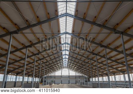 Building Frame Composition. Steel Frame Of The Building With Timber Joists And Sandwich Panels On Th