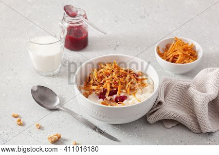 rice pudding with Norwegian brunost traditional brown cheese and raspberry jam