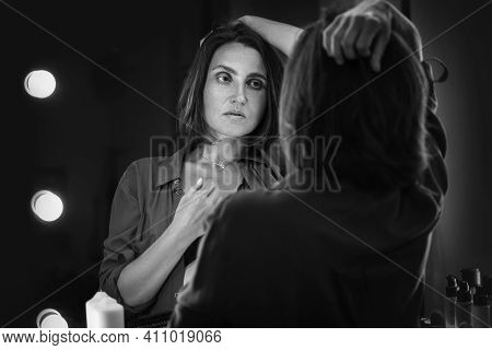 Sensual Black And White Boudoir Portrait Of Seductive Female Gazing On Her Mirror Reflection As She