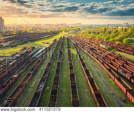 Aerial View Of Freight Trains At Sunset. Railway Station. Rusty Wagons On Railroad. Heavy Industry.