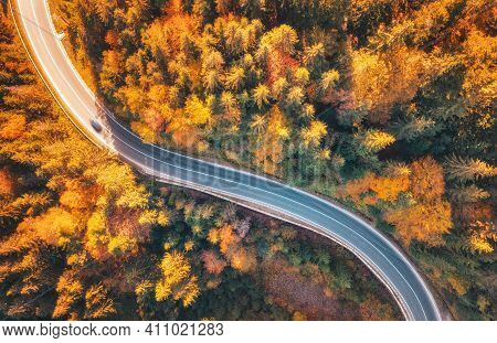 Aerial View Of Mountain Road In Beautiful Forest At Sunset In Autumn. Top View From Drone Of Winding