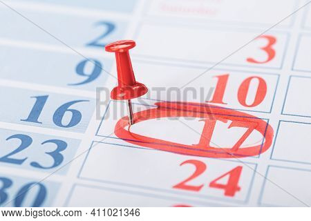 Calendar Page For 2021, Marked With An Important Date With A Red Pin And Circled In Red. Chronology,