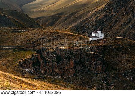 White House Among The Mountains. Beautiful Autumn Landscape. Small House In The Mountains. Beautiful