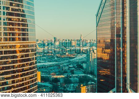 Urban Sunrise In Moscow With Sunlighte Facades Of Glass Skyscrapers. Morning Sunrise In The City In