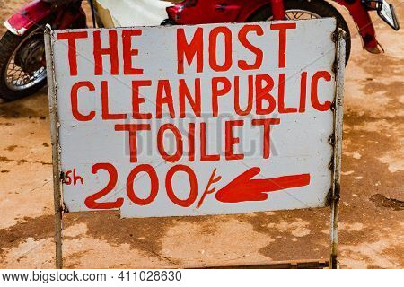 A Sign Pointing The Way To A Clean Toilet In Africa