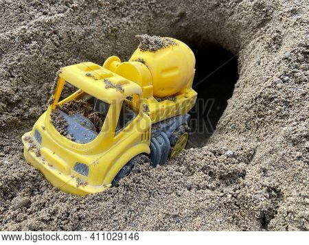 Toy Truck Drives Through A Tunnel In The Sand