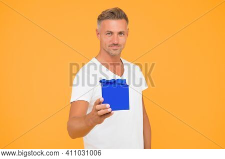 Buy Present For Any Occasion. Handsome Guy Hold Present Box Yellow Background. Birthday Present. Gif
