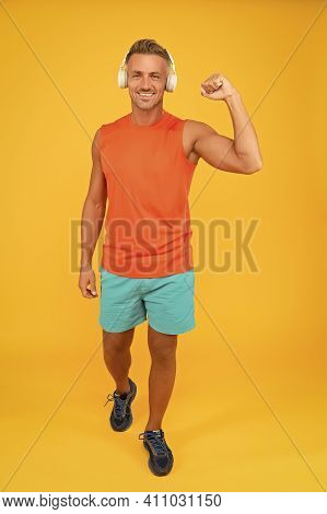 Regular Workout. Mature Coach. Music For Fitness. Sportsman Listen Music. Sportsman Training. Strong