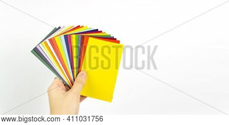 Female Hand Holding Color Of The Year 2021 - Illumanating. Color Trend Palette. Color Trend Palette.