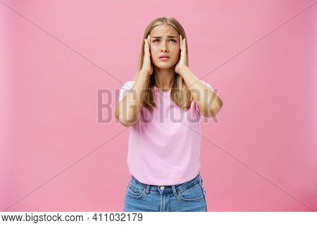 Woman Trying Recall Important Number Touching Temples With Hands Looking Up Concerned And Focused Ha