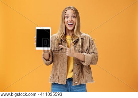 Woman Showing Friends New Digital Tablet First Purchace Of Autumn. Charismatic And Enthusiastic Exci