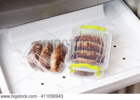 Frozen Cutlets In A Container In A Refrigerator. Ready Frozen Food. Fast Cooking Concept. Semi Finis