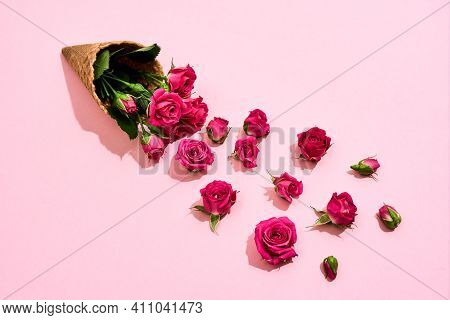 Beautiful Bouquet Of Roses Lying On A Pink Background. Bouquet For The Spring Holiday On March 8 Lyi