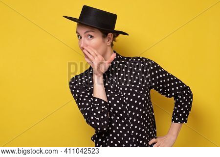 Young Beautiful Woman In Black Hat Holding Hand On Mouth Telling Secret Rumor, Whispering