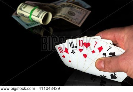 Poker Cards With Full House Or Full Boat Combination. Close Up Of A Gambler Hand Is Holding Playing