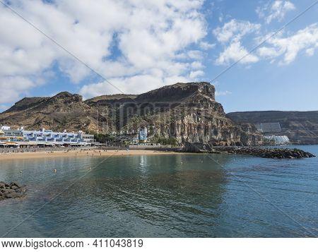 Puerto De Mogan, Gran Canaria, Canary Islands, Spain December 18, 2020: View On The Public Beach Wit