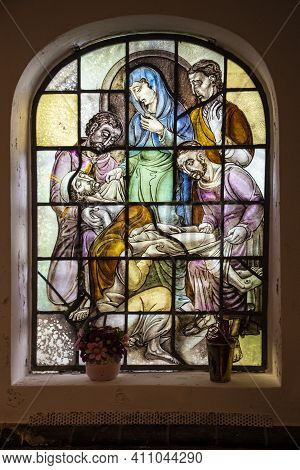Afferden, Netherlands, May 20, 2021: Stained Glass Window In The Church