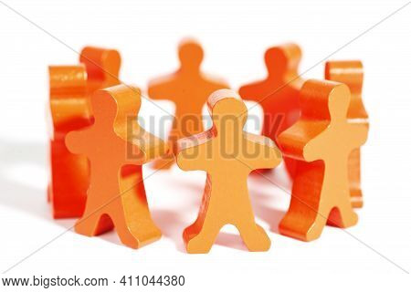 Team Of Wooden Doll People Holding Hands. Business Team, Teamwork, Team Spirit. Team Circle