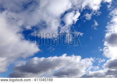 Beautiful Celestial Landscape With White Cumulonimbus Clouds High In The Stratosphere On A Sunny Sum
