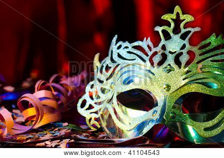 Carnival mask with a red silk background