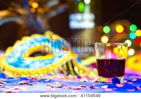 A drink with a carnival background