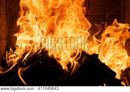 Burning Cozy Fire With Logs. Glowing Fireplace. Fire Texture. Flame Background. Abstract Flames. Bur