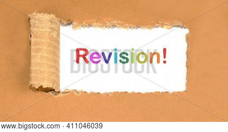 Revision Word Written On Torn Cardboard On A White Background.