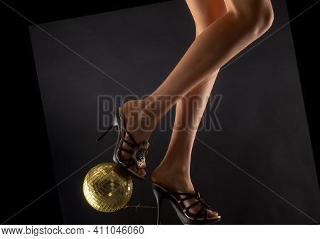 Disco And Party Legs. Celebrating. Disco-ball On High Heels. Woman Heels With Gold Ball. Celebrate C