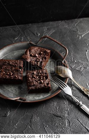 Dark Cacao Brownies With Choco Drops On Old Metal Tray With Vintage Silverware On Dark Background Hi