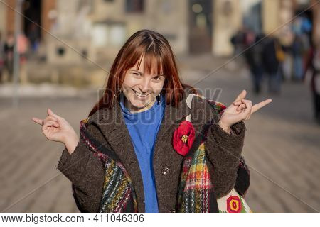 Laughing Young Woman 20-25 Years Old With Dyed Red Hair And A Little Overweight On The Background Of
