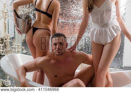 Sexual Guy In Bath. Polygamy Love. Rich Man With Sexy Girls In Bathroom. Swinger, Orgy Or Trio In Ba