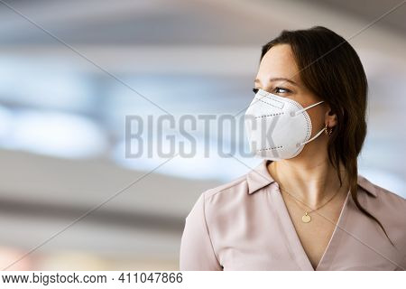 Close Up Of Woman Wearing N95 Medical Face Mask