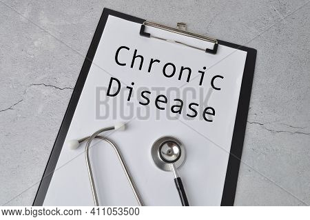 Stethoscope And File Written With Chronic Disease.