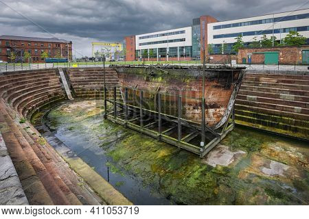 Belfast, Northern Ireland - June 27, 2017: The original caisson gate Hull No 50 stands on beside SS Nomadic at Hamilton Dock is oldest Harland and Wolff vessel anywhere in the world.