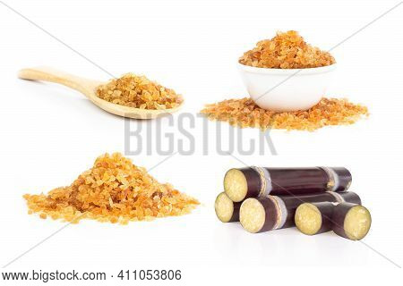 Set Of Sugarcane And Brown Sugar Isolated On White Background